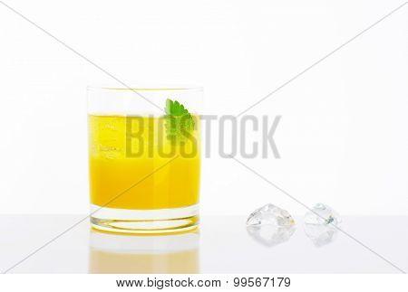glass of fresh orange juice with ice on white background