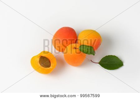 overhead view of whole and halved apricots