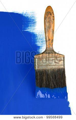 Vintage paintbrush with blue paint