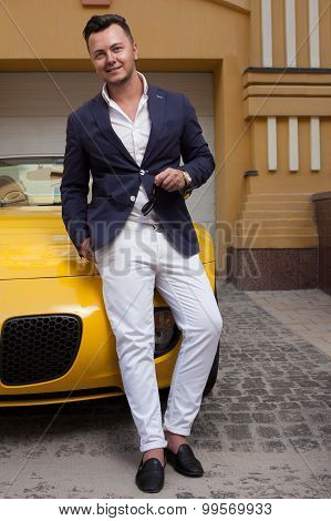 Stylish Man Posing With Convertible Sportcar