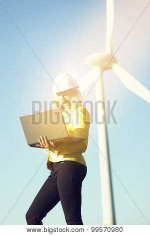 Woman engineer with wind turbine
