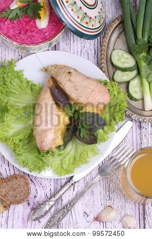 Chicken Breast Baked With The Cheese, Submitted With Vegetables And Greens