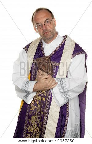Catholic Priest With A Bible In Worship