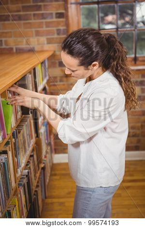 Librarian sorting books on the shelves at the elementary school