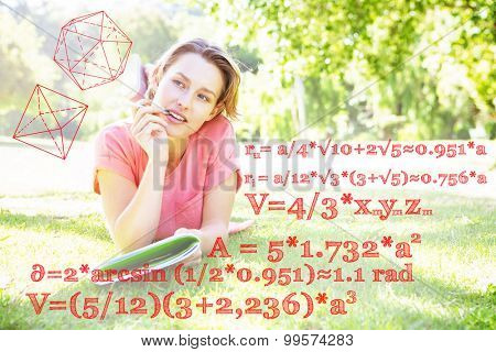Math problems against pretty woman reading book in park
