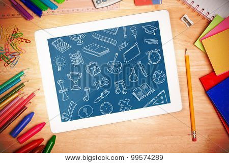 school doodles against students desk with tablet pc