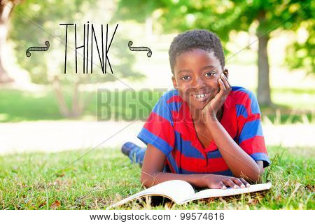 The word think against little boy reading in the park