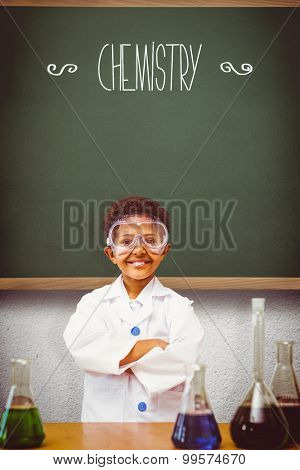 The word chemistry and cute pupil dressed up as scientist against green