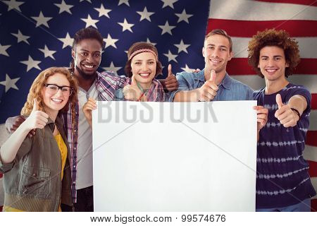 Fashion students smiling at camera together against united states of america flag