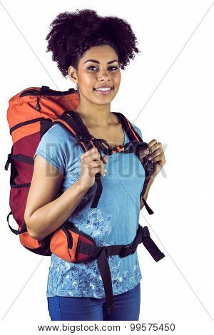 Portrait of a young woman with backpack on a white background