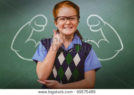 Cute pupil dressed up as teacher against green chalkboard