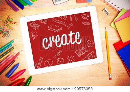 The word create and school doodles against students desk with tablet pc