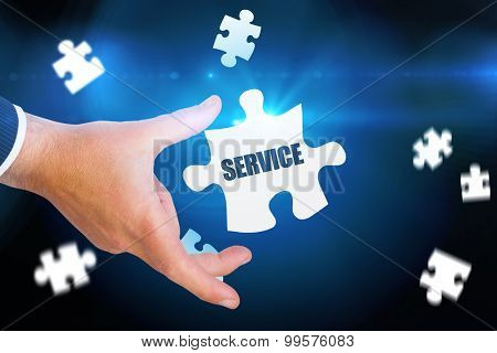 The word service and businessman pointing with his finger against blue background with vignette