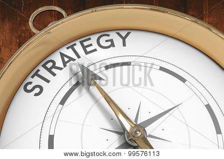 Compass pointing to strategy against weathered oak floor boards background