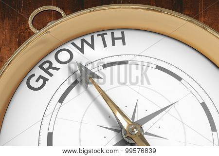 Compass pointing to growth against weathered oak floor boards background