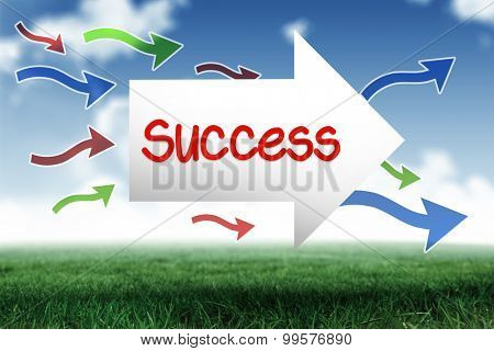 The word success and arrow against blue sky over green field