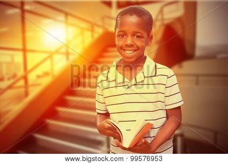 happy pupil with book against empty stair way