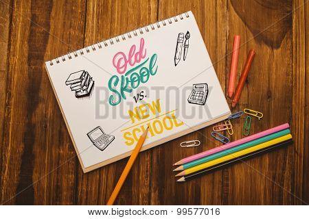 school doodles against notepad on student desk