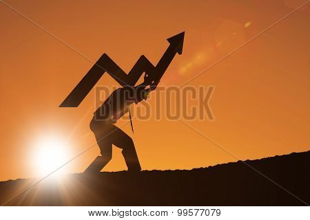 businessman with arrow against orange sky