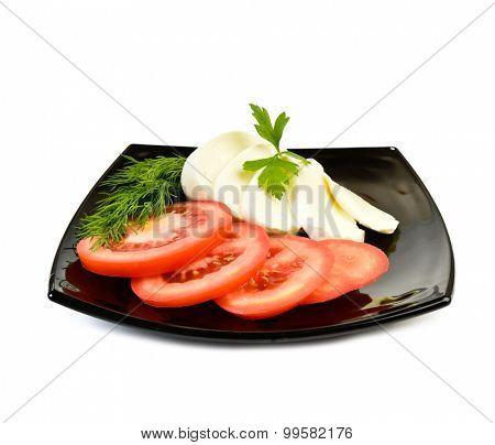 Mozzarella on a plate at white background