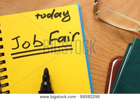 Notepad with job fair.