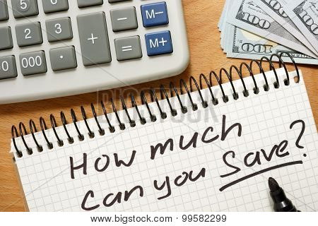 Notepad with how much can you save. Home budget concept.