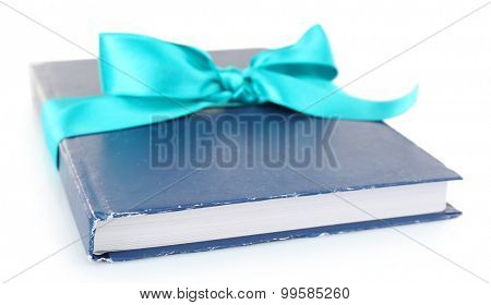 Book wrapped with color ribbon isolated on white