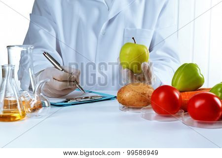 Scientist examines vegetables in laboratory