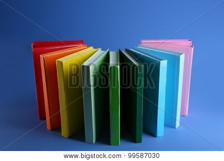 Colorful books on blue background