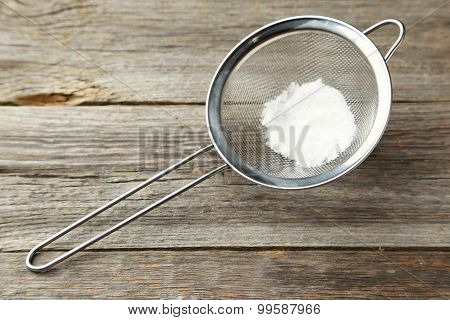 Silver Sieve With Flour On Grey Wooden Background