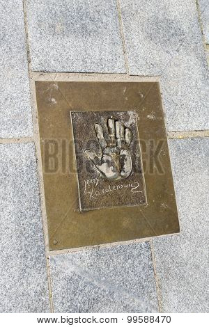 MIEDZYZDROJE, POLAND - AUGUST 16: Hand imprints in brass on a sidewalk of famed Polish movie director Jerzy Kawalerowicz at