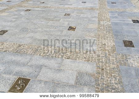 MIEDZYZDROJE, POLAND - AUGUST 16: Hand imprints in brass on a sidewalk of famed Polish movie stars at