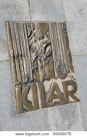 MIEDZYZDROJE, POLAND - AUGUST 16: The memorial plaque in brass on a sidewalk of famed Polish movie music composer Wojciech Kilar at