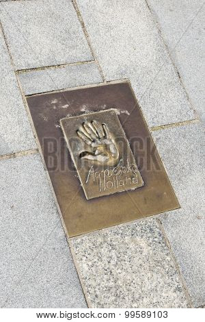 MIEDZYZDROJE, POLAND - AUGUST 16: Hand imprints in brass on a sidewalk of famed Polish movie director Agnieszka Holland at