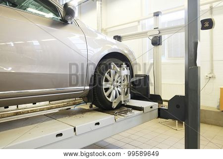 Image of a car in a repair garage