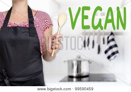 Vegan Chef Holding Wooden Spoon Background