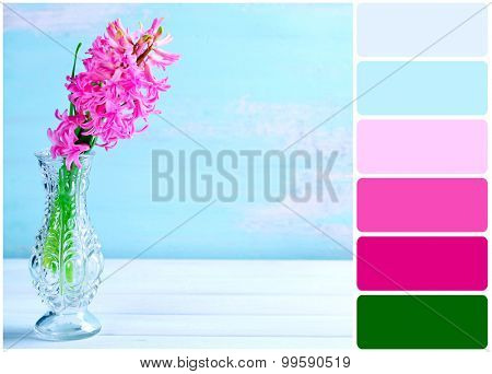 Beautiful hyacinth flower in vase on wooden table and palette of colors