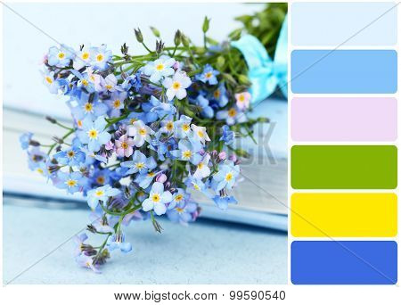 Forget-me-nots flowers on book and palette of colors