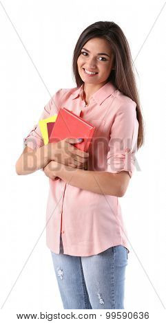 Young girl with books isolated on white