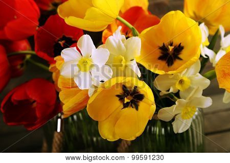 Beautiful bouquet of tulips and narcissus, closeup