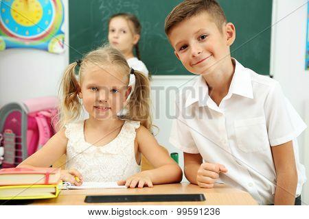 Portrait of happy pupils at lesson