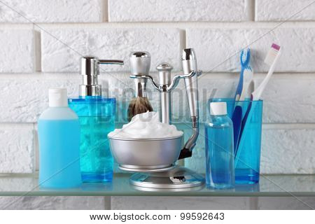 Male luxury shaving kit on shelf, on bricks wall background