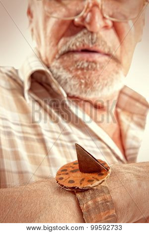 Life concept. Elderly man looks at the sundial
