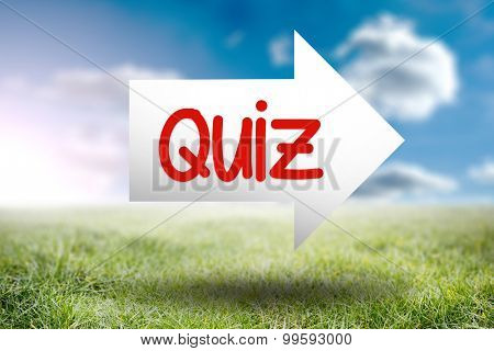 The word quiz and arrow against sunny landscape