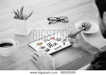 The word win and creative businessman writing notes on notebook against business icons