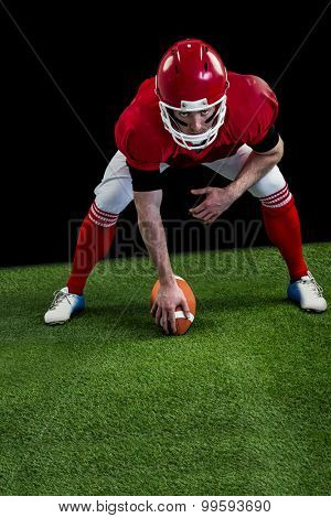 American football player starting football game on american football field