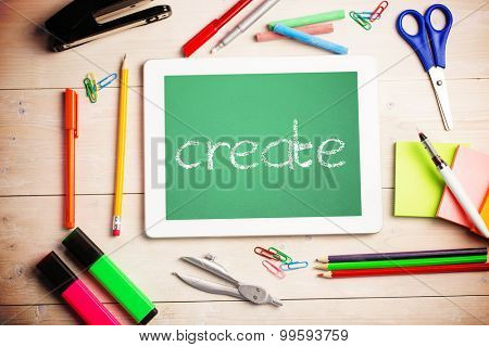 The word create and students desk with tablet pc against green