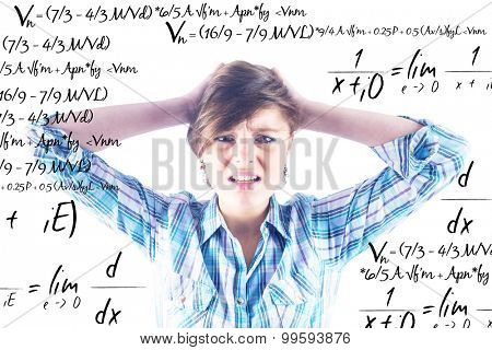 Pretty brunette getting a headache against maths equation