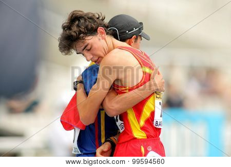 BARCELONA-JUNE, 13: Alvaro Martin of Spain and Eider Arevalo embraces when finished an event of of the World Junior Athletics Championships at the Olympic Stadium on July 13, 2012 in Barcelona, Spain