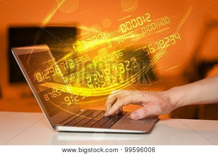 Man typing on modern notebook with future number technology data coming out